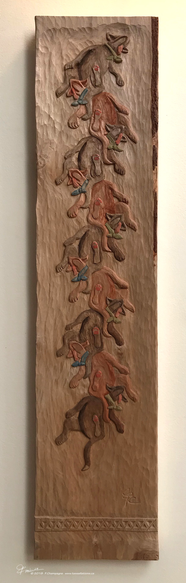 Nested Dogs tessellation carved in a slab of alder, ©2018 F.Champagne